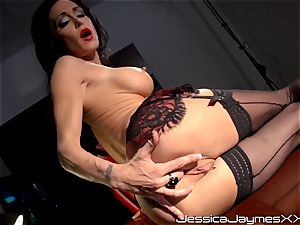mischievous black-haired Jessica Jaymes thumbs her yummy fuckbox pie in her office