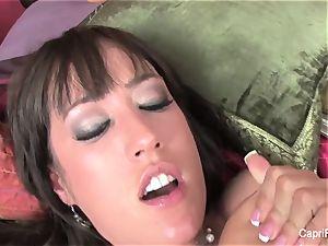 buxom Capri Cavanni pummels on the bed