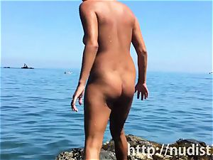Spying on a ultra-cute sweetie at the naturist beach spycam webcam