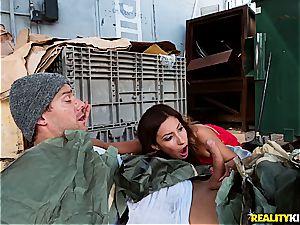 Jade Jantzen pummeling a hobo with her husband nearby